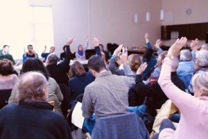 Co-op members vote at a members' meeting