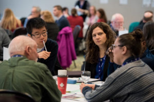 Members talk thoughtfully at a workshop