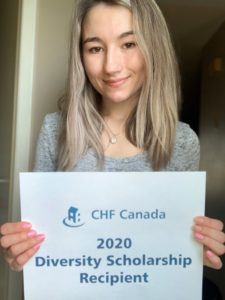 "A person with long light hair holds up a sign that says ""CHF Canada 2020 Diversity Scholarship recipient"""