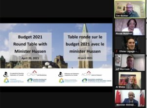 """Screenshot with text """"Budget 2021 Round Table with Minister Hussen"""" and images of participants"""